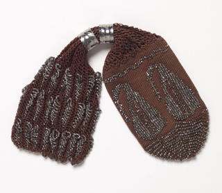 Brown silk miser's purse with two steel rings and steel beads, in paisley pattern at rounded end.