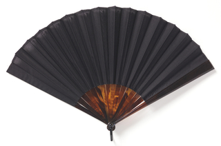 Pleated mourning fan. Leaf of black organdy. tortoise shell guards and sticks. Black enameled metal bail.