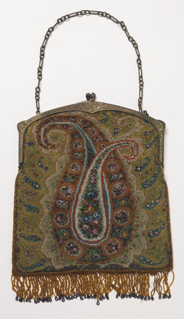 Purse with a metal clasp frame and chain, fringed bottom. Beaded knitting with a design of a large paisley.