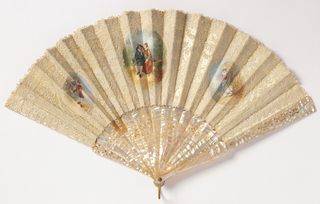 Pleated fan with white lace on white satin leaf. The obverse has three handpainted cartouches showing in the center two lovers seated on a bench. Right hand cartouche has a woman walking in a wood while the left has a man with a mandolin. Mother-of-pearl sticks have carved openwork (à jour).