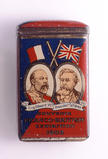 """Rectangular, lid curved, featuring red, white and blue enameled decoration, gold oval framed portraits of Britain's King Edward VII on left and France's President Armand Fallières on right, the French and British flags above them, their names inscribed on flowing banners beneath, inscribed below """"Souvenir, Franco-British Exhibition, 1908."""" Reverse features advertisement, inscribed """"Muratti's Ariston Cigarettes, Smoked All Over The World."""" Side panel inscribed """"B. Muratti Sons & Co. Ltd."""" Opposite side panel inscribed """"Manchester, London, Berlin, & Co. Ltd."""" Lid hinged on upper left. Striker on bottom."""