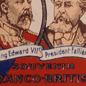 "Rectangular, lid curved, featuring red, white and blue enameled decoration, gold oval framed portraits of Britain's King Edward VII on left and France's President Armand Fallières on right, the French and British flags above them, their names inscribed on flowing banners beneath, inscribed below ""Souvenir, Franco-British Exhibition, 1908."" Reverse features advertisement, inscribed ""Muratti's Ariston Cigarettes, Smoked All Over The World."" Side panel inscribed ""B. Muratti Sons & Co. Ltd."" Opposite side panel inscribed ""Manchester, London, Berlin, & Co. Ltd."" Lid hinged on upper left. Striker on bottom."