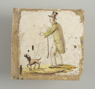 Man in long white trousers, green coat and top hat, walking toward the left, leading a dog on a leash, and carrying a walking stick.