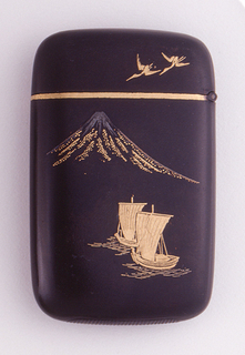 Rectangular, rounded corners, dark brown, lacquered metal body, featuring 2 gilded sail boats in lower right foreground, a gilded Mt. Fuji with silvered peak in upper left background, 2 gilded, flying cranes on upper right side of lid. Reverse features 2 gilded, flying cranes on body, single, gilded, flying crane on upper right of lid. Lid hinged on side and delineated from body by a continuous gold band that wraps from front to back. Striker on bottom.