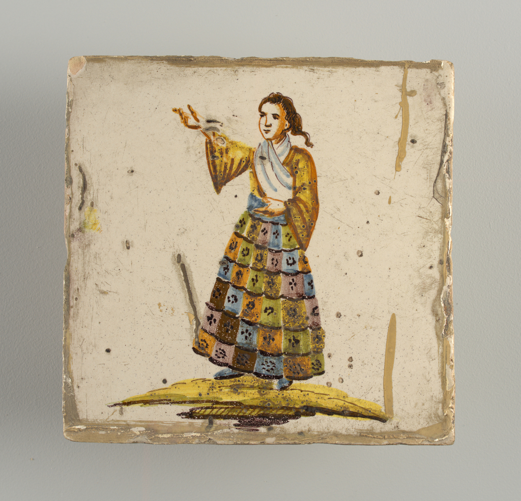 Standing woman, right arm raised and pointing to upper corner; dressed in multi-colored checkered skirt, yellow shirt and white shawl. Chinoiserie type decoration.