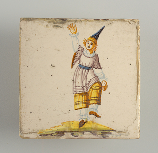 Dancing man, dressed in white pantelettes, yellow skirt, white and manganese overshirt, and wearing pointed blue, brimless hat. Chinoiserie type of decoration .