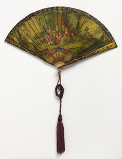 "Brisé fan. Ivory sticks painted to resemble ""vernis martin"" showing a group of figures seated under a tree; gorge and guard painted with Chinoiserie. Silk connecting ribbon and purple tassel. Metal bail and faceted red stone at rivet."