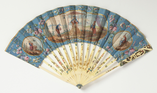 Pleated fan. Painted and gilded paper leaf. Obverse: three cartouches with figures in the Chinoiserie style. Reverse: Chinoiserie figure. Carved and painted ivory sticks stained blue at rivet; foil behind guards. Glass stone at rivet.