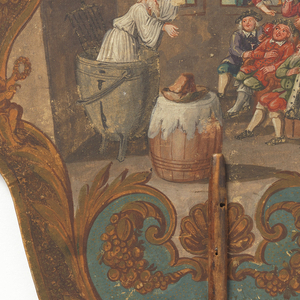 Handscreen with hand-painted paper leaf and turned wood handle. Obverse: rustic interior scene showing  a bearded man with a pot on his head emerging from a large cooking vessel before a group of men; two women observe from the window. Reverse: paper painted with flowers, with three applied engravings with French text.