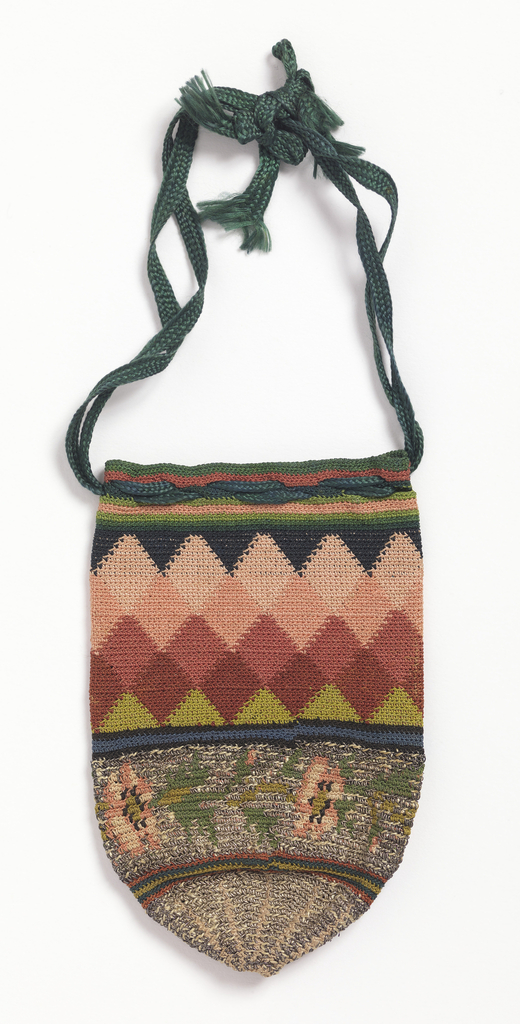 Small spade-shaped crocheted purse. Bottom portion contains metal thread with pink and green silks in a floral design. The top is all silk, in reds, pinks and green, in a harlequin pattern. Drawstring of braided green silk.