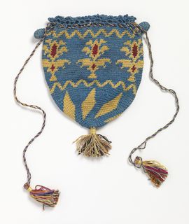 Drawstring bag of a tapering shape. Design of yellow and red shapes on a blue background. Two blue crocheted 'ears' at each side to aid in opening purse.