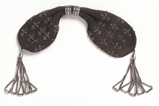 Miser's purse, crocheted of black silk with pattern of crosses and tassels of steel beads.