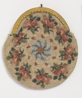 Round flat purse with gilt metal clasp. Bouquets of roses in pinks and greens surround a central blue motif. Crocheted in a circular fashion from the center out.