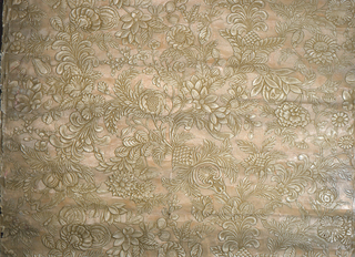 Stylized floral and foliate design with scattered butterflies. Heavily embossed to imitate tooled leather. Printed in ivory and ecru.