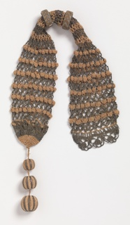 Miser's purse crocheted in pink silk and silver metallic threads, with silk and silver rings and a three-ball tassel at one end.