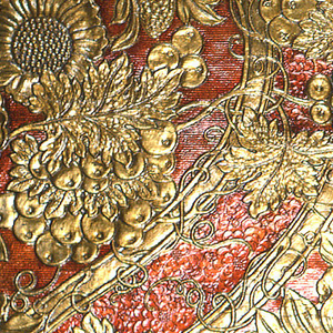 Bands of strapwork entwined in grapevine tendrils framing crested bird perched on branch. Pomegranates, sunflowers, grapes and grape leaves, fantastic floral and foliate forms. Printed in metallic gold and scarlet.