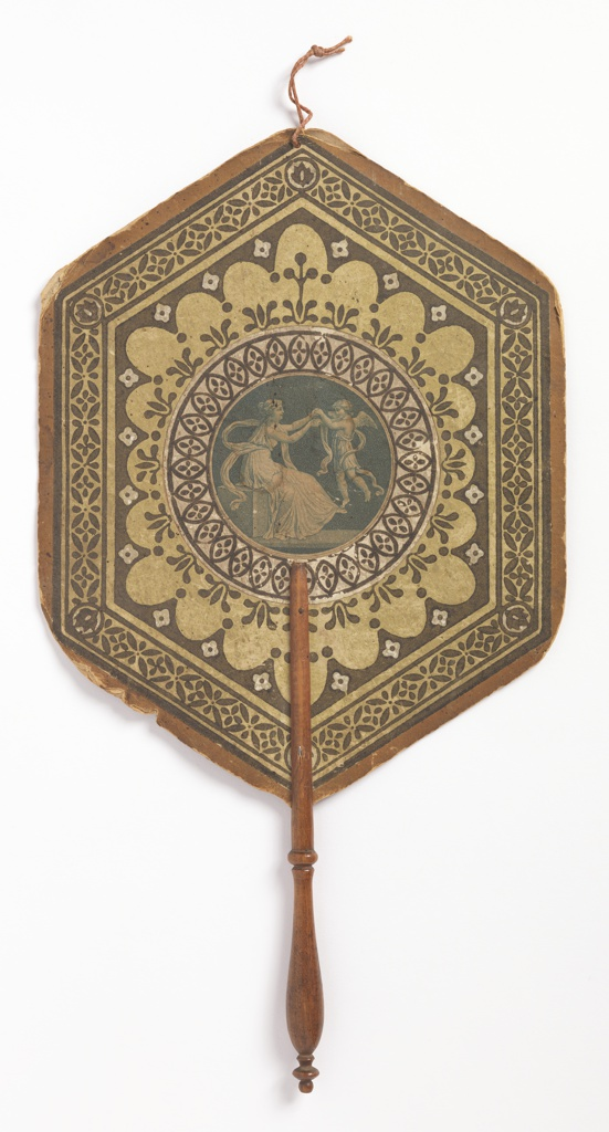 Handscreen with a hexagonal leaf; circular medallion with a female figure in classical dress playing with a cherub. Surrounded by stenciled or block-printed borders of stylized floral oranment in brown and white.