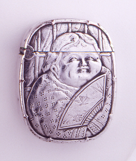 Oblong, rounded corners, featuring raised decoration of plump woman in kimono holding fan with butterfly and flower motifs; reverse features plump male in kimono holding a toothpick to his mouth, bamboo foliage in backround. Lid hinged on upper side. Striker on bottom.