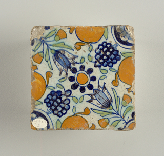Painted in blue, green, yellow band brown; tulips, grapes and oranges, with foliage and foliated circles.