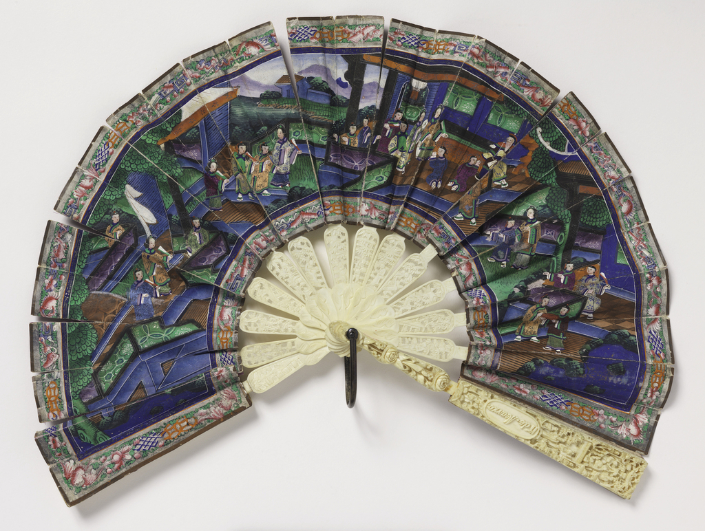 Fan with ivory sticks and paper leaf. Leaf painted on front and back with scenes of Chinese life. Faces of figures are painted on small bits of applied ivory. Garments of figures are made of silk applied to the paper leaf. The ivory sticks are lace-carved with flowers, figures, etc. Guards are carved in high relief.