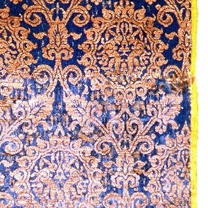 Medallions holding addorsed hares in gold on dark blue.