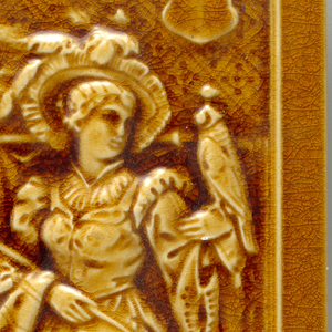Rectangular molded tile with high relief border surrounding female figure in Renaissance costume, holding falcon on arm and with hunting dog at feet.Figure stands before draped wall. Thick transparent ochre glaze creates highlights and shadows around relief details.