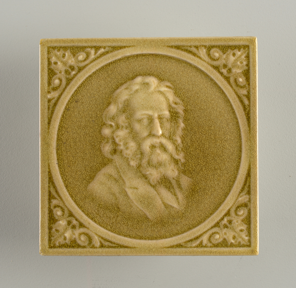 Square tile, molded with relief bust of Walt Whitman within a circular frame, which floral corners. Glazed overall in transparent sage green, highly cracked.