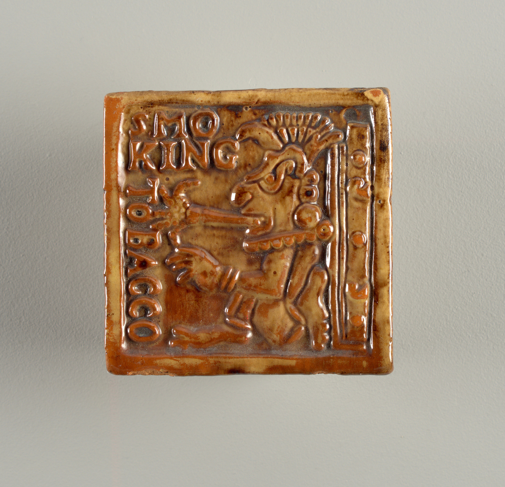 "Square tile. Variegated brown and fubb. Molded design shows seated Maya Indian facing left, smoking large ""cigar"". Name of title at left and a ""date glyph"" of bars and dots at right."