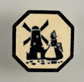 Octagonal molded tile. Black glazed border enclosing molded (cloisonne) figure of Dutch girl and windmill, both in black silhouette on white ground