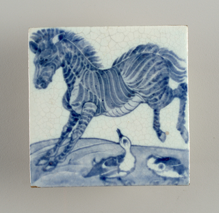 Square tile of reddish clay with grogg added. Bluish white crackled glaze with zebra and two sucks painted in blue.