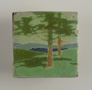 "Light buff earthenware body  with press-molded design of trees in a landscape.  Various mat glazes inlight green, dark green, brown and blues defined by raised partitions. The design of this tile is associated with a group of eight tiles that when placed together form a fireplace frieze entitled ""The Pines"".  Each element of the design is segmentsed by cloisons of clay, the raised contours partitioning the inlaid  glazes. Copper frame."
