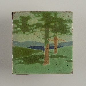 """Light buff earthenware body  with press-molded design of trees in a landscape.  Various mat glazes inlight green, dark green, brown and blues defined by raised partitions. The design of this tile is associated with a group of eight tiles that when placed together form a fireplace frieze entitled """"The Pines"""".  Each element of the design is segmentsed by cloisons of clay, the raised contours partitioning the inlaid  glazes. Copper frame."""