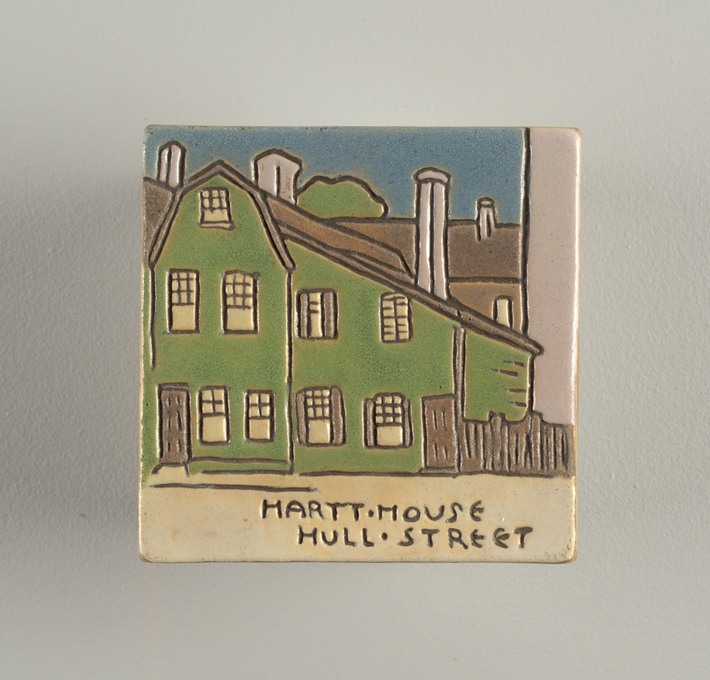"""Glazed tile depicting a green three story house in a neighborhood. Underneath the image says: """"Hartt House Hull Street""""."""