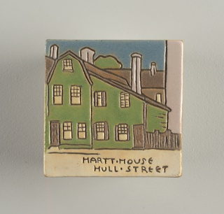 "Glazed tile depicting a green three story house in a neighborhood. Underneath the image says: ""Hartt House Hull Street""."
