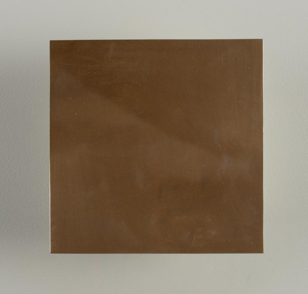 Square flat molded tile. Surface with metallic bronze finish; underglazed on reverse.