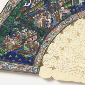 Pleated fan. Painted paper leaf showing village scene; figures with appliquéd silk costumes and painted ivory faces. Ivory sticks pierced and carved à jour. Gilt metal bail with knotted red and purple silk tassel.
