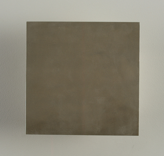 Square flat molded tile. Sufarce with metallic pewter finish. Unglazed on reverse.