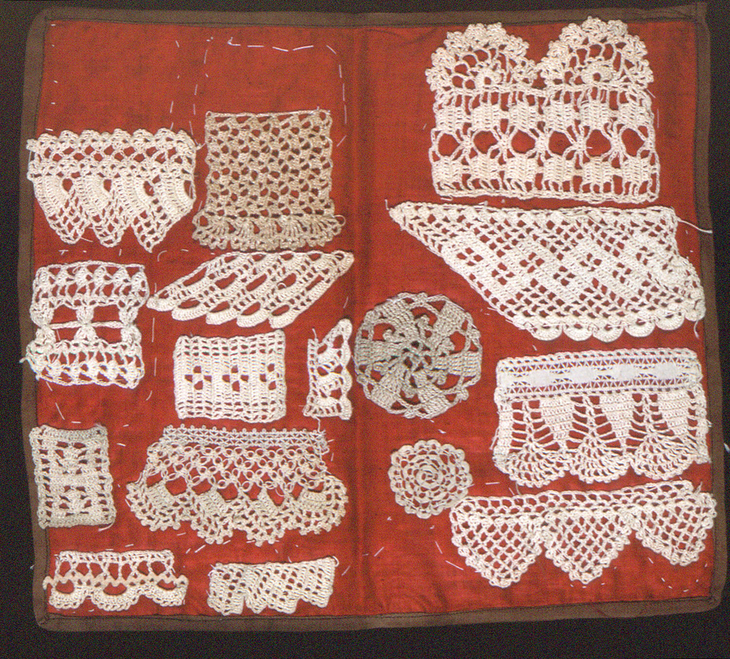 Samples of crochet sewn to both sides of a square of red cotton. 16 pieces on one side, 16 pieces on the other.
