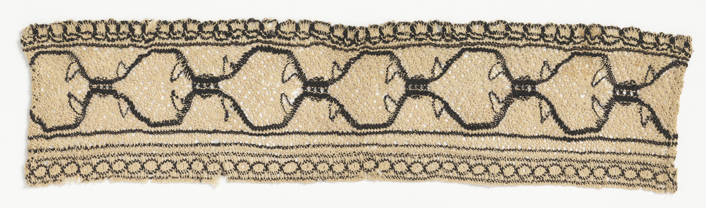Beige and black lace with an ogival pattern.