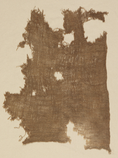 Fragment of a plain woven cloth in brown cotton.