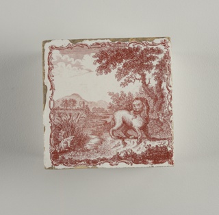 Red transfer decoration on a white ground, showing landscape with mountains in left background; foreground with lion standing before a tree at right, and looking at a frog to its left; the scene surrounded by a framework of rocaille scrolls.