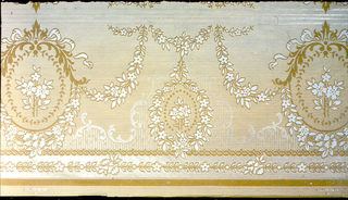 Narrow floral medallion frieze, printed in browns and liquid mica white, with medallion being connected by floral swags, above guilloche banding and small floral banding.