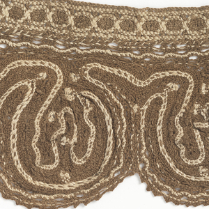 Two pieces of a scalloped collar with light brown (embroidery?) .