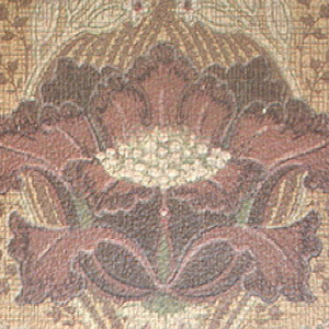 Large central crimson blossom with long curving leaves, small flowers above; rinceaux in brown on light brown ground.