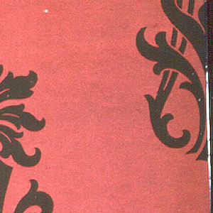 Staggered anthemion motifs in black on a red ground.