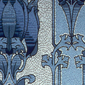 Stylized blue floral stripe, printed in shades of blue on mottled blue ground.