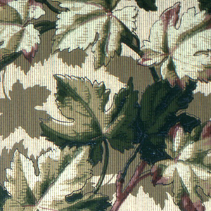 All-over dense foliage design. Intermittent red leaves among predominant green and yellow leaves. Printed on tan ground.