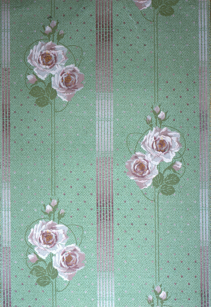 Floral stripe design. Pink and white flowers with buds printed on narrow stripe. This alternates with wider stripe. Printed on  spotted green background.