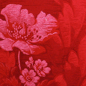 Cluster of red poppy flowers, set within dense foliage. Printed in shades of red on red ingrain paper.