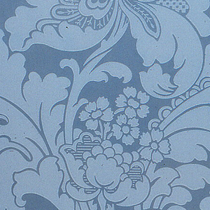 Large-scale scrolling foliage supporting bulbous flower. Printed in light blue on pale blue mica background.